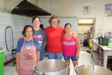 Jody Jones and Lucy Elshaug work with cooks in the mission soup kitchen.